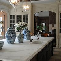 The Enchanted Home - kitchens - rustic, wood, box beams, ivory, glass-front, kitchen cabinets, ebony, stained, kitchen island, calcutta, marble, countertops, glass, lanterns, ming, ginger jars,
