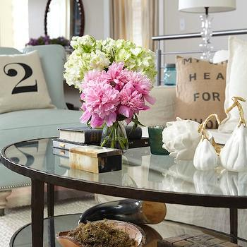 Jillian Harris - living rooms - oval, glass-top, coffee table, blue, chair, linen, slipcover, sofa, vintage, grain sack, pillow, oval coffee table, iron coffee table, iron and glass coffee table, glass top coffee table, oval glass top coffee table,