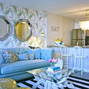Jillian Harris - living rooms - wallpaper, accent wall, blue, linen, tufted, chesterfield, sofa, white, black, striped, rug, branch, coffee table, striped rug, black and white rug, black and white striped rug,