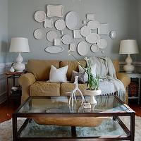 Chic, cozy living room with gray walls paint color, white chair rail & wainscoting, ...