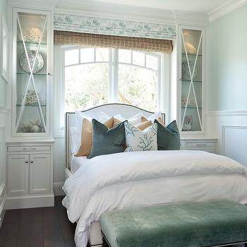 Barclay Butera - bedrooms - pale, blue, walls, wainscoting, bed in front of window, white, camelback, headboard, bed, nailhead trim, blue, tan, velvet, pillows, white, built-ins, seafoam, green, velvet, tufted, bench, bed in front of window,