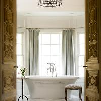 Liz Williams Interiors - bathrooms - iron, cage, pendant, blue, linen, drapes, freestanding, tub, Architectural Accents Door, Walker Zanger Helsinki Collection Chevron Field Floor Tiles - Silver Dusk,