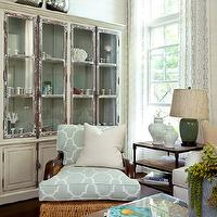 Cottage living room with sage green walls, vintage glass-front cabinet with ...