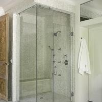 Liz Williams Interiors - bathrooms - shower surround, corner, seamless glass shower, walk in shower design, glass shower design, Walker Zanger Helsinki Collection Chevron Field Floor Tiles - Silver Dusk, Walker Zanger Vintage Glass in Onyx Luster Tiles,