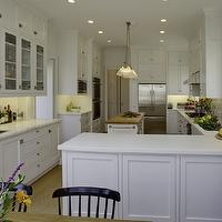 Mahoney Architects & Interiors - kitchens - peninsula, white, shaker, floor to ceiling, kitchen cabinets, marble, countertops, kitchen island, butcher block, top,