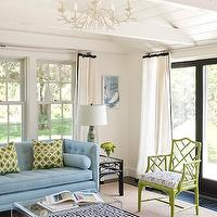 Annsley Interiors - living rooms - white, drapes, black, ribbon, trim, green, faux bamboo, chair, bamboo chairs, green bamboo chair, faux bamboo chair, green faux bamboo chairs, Ballard Designs 5-Light Coral Chandelier, Jonathan Adler Blue Greek Key Rug, CB2 Peekaboo Clear Coffee Table, Jonathan Adler Lampert Sofa,