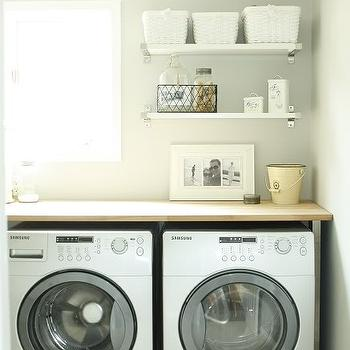 In the Fun Lane - laundry/mud rooms - white, front load, washer, dryer, white, shelves, gray, walls, laundry shelves, laundry room shelves, laundry room shelving, laundry room shelf,