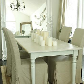 In the Fun Lane - dining rooms - jute, rug, candles, white, farmhouse, dining table, turned legs, taupe, linen, slipcover, dining chairs, white, baroque, floor mirror, farmhouse table, white farmhouse table, dining table, white dining table, white farmhouse dining table,