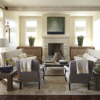 Urban Grace Interiors - living rooms - rustic, box beams, limestone, fireplace, flanked, built-ins, pale, yellow, walls, gray, curvy, sofas, glass, hourglass, lamps, French doors, ransom, windows, furniture arrangement, living room furniture arrangement,