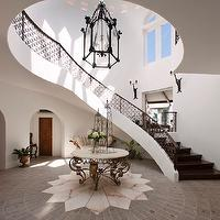 entrances/foyers - 2-story, marble, top, foyer, table, iron, winding, staircase, 2 story foyer, two story foyer,  Spanish style home with 2-story
