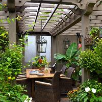 Brandon Barre Photography - decks/patios - gray, pergloa, gray, doors, teak, dining table, wicker, dining chairs, pergola, garden pergola, outdoor dining pergola,