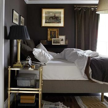 House Beautiful - bedrooms: chocolate brown, curtains, chocolate brown, walls, black, leather, tufted, bed, gray, linen, bed, chocolate, brown, shams, antique, brass, etagere, nightstand, brass, lamp, black, shade, brass etagere, etagere, brass nightstand,
