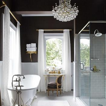Annie Brahler - Stunning bathroom with dark chocolate walls paired with white ...