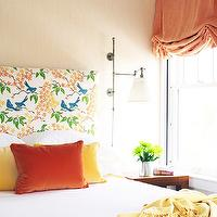 Caccoma Interiors - bedrooms - tan, grasscloth, wallpaper, orange, blue, birds, fabric, headboard, orange, yellow, pillows, yellow, throw, orange, roman shade,