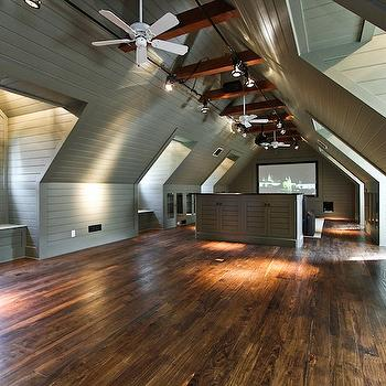 Pricey Pads - media rooms - attic, green, wall paneling, built-in, TV, nook, attic movie room,  Amazing attic movie room with green wood paneling