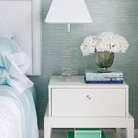 Blue Venetian plaster walls, white headboard with blue trim, square glass lamp, white ...
