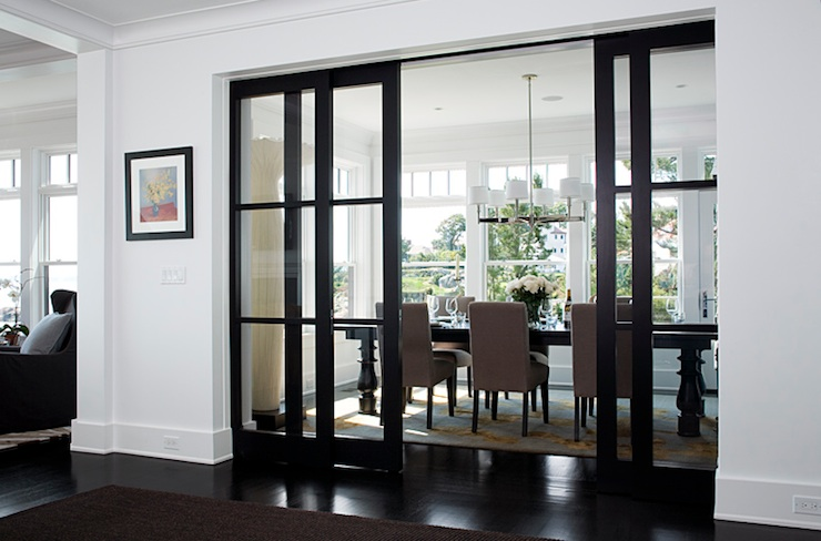 dining rooms - black glass pocket doors glossy black dining table taupe dining chairs  Contemporary dining room with glass pocket doors, glossy