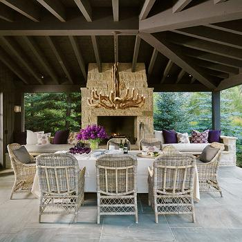 M. Elle Design - decks/patios - covered, stone, fireplace, flanked, built-in, benches, purple, pillows, covered deck, covered patio,  Covered