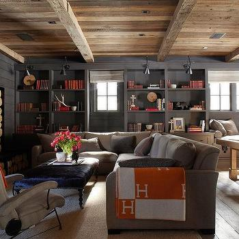 M. Elle Design - basements - charcoal, gray, wood paneling, walls, built-in, TV, nook, built-in, bookcase, light gray, sectional, sofa, black, leather, tufted, ottoman, orange, throw, pool table, built-in, window seat, hermes throw, hermes blanket,