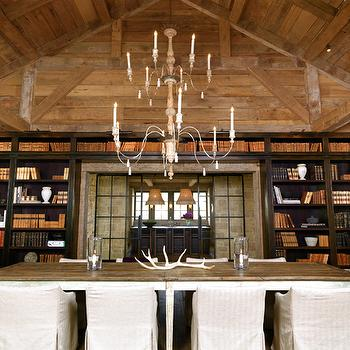 M. Elle Design - dining rooms - candle, chandelier, vaulted, ceiling, chocolate, brown, built-in, bookcase, salvaged wood, dining table, slipcover, side, chairs, white, camelback, captain, chairs, built in bookcase, chocolate brown bookcase, bookcase framing door, door bookcase,