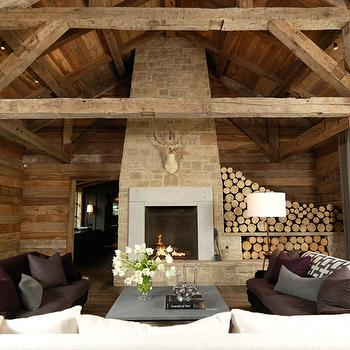 M. Elle Design - living rooms - rustic, wood paneling, stone, fireplace, hearth, purple, sofas, gray, purple, pillows, concrete, top, square, coffee table,