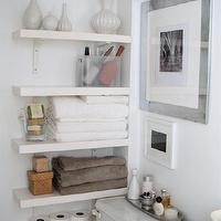 The Order Obsessed - bathrooms - white, floating shelves, silver, frame, silver, oval, tray,  Small bathroom with lots of storage space - white