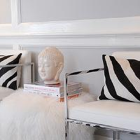 Sam Allen Interiors - dens/libraries/offices - polished nickel, chairs, zebra, pillows, white, shag, ottoman, pouf, Buddha head, zebra pillows, black and white zebra pillows,