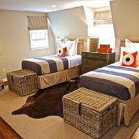 Sam Allen Interiors - boy's rooms - tan, walls, army green, chest, red, leather, stacking, boxes, rope, lamp, brown, cowhide, rug, layered, sisal, rug, wicker, trunks, twin, tan, headboards, French, brass, tacks,