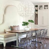 At Home in Arkansas - dining rooms - ivory, leather, banquette, salvaged wood, dining table, top, Rossy, chairs, Ikea PS Maskros Pendant, F Schumacher Twiggy Silver Wallpaper, John Magee of M2 Gallery Banquette, John Magee of M2 Gallery Table Base,