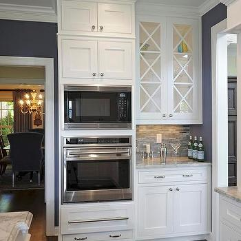 J.S. Brown & Co. - kitchens: Built-in Wolf single oven, Wolf microwave, Wolf warming drawer, white cabinets, glass tile backsplash, white granite countertops, dark oak floor, alpine white, alpine white granite, alpine white granite counters, alpine white granite countertops,