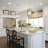J.S. Brown & Co. - kitchens - Alpine White Granite, glass backsplash, white cabinets, mantel style hood, dark oak floor, lantern, Sub-Zero refrigerator, Wolf range top, Landmark Lighting Chesapeake 6 Light Pendant,