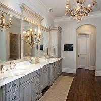 French master bathroom with gray distressed cabinets with calcutta marble ...