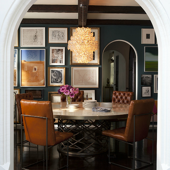 Nate Berkus Design - dining rooms - navy blue, walls, arched doorway, eclectic art gallery, metal, round, dining table, orange, leather, tufted, dining chairs, orange dining chairs, orange leather dining chairs, orange tufted dining chairs, orange leather tufted dining chairs,