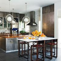 Nate Berkus Design - kitchens - pot filler, metal, cage, pendants, metal, kitchen cabinets, butcher block, tops, marble, subway tiles, backsplash, pot filler, slate, tiles, marble, top, French, kitchen island, metal cabinets, metal kitchen cabinets,
