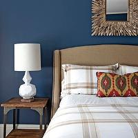 Design Manifest - boy's rooms - bold, blue, walls, red, green, yellow, ikat, pillow, industrial, table, camel, linen, wingback, headboard, French, brass, tacks, blue walls, blue paint, blue paint color, blue boys bedroom walls, blue boys bedroom paint, blue boys bedroom paint color, West Elm Terracotta Lamp, Etsy Driftwood Mirror,