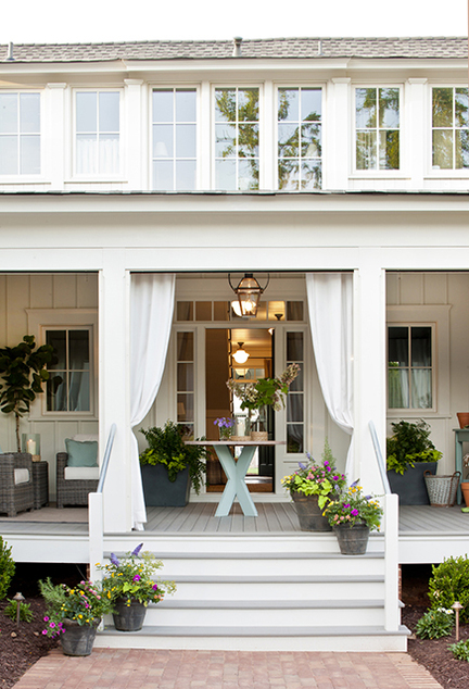 Southern Living - porches - wraparound, covered, porch,  Wraparound covered porch with outdoor furniture.