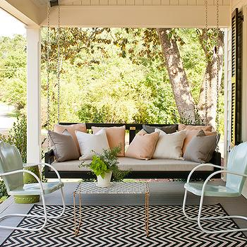 Southern Living - porches - glossy, black, shutters, porch swing, peach, pink, gray, pillows, black, white, chevron, outdoor, rug, lime, green, garden stool, black and white rug, white and black rug, chevron rug, black and white chevron rug, white and black chevron rug, chevron print rug,