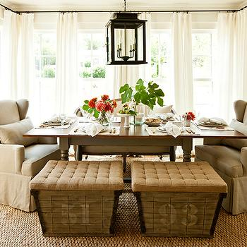 chic cottage dining room with French burlap storage ottomans, seagrass rug, taupe ...