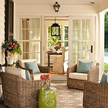 Southern Living - porches - covered, wicker, chairs, powder, blue, pillows, black, shutters, covered porch, beadboard covered porch, Ballard Designs Suzanne Kasler Ikat Indoor/Outdoor Rug,