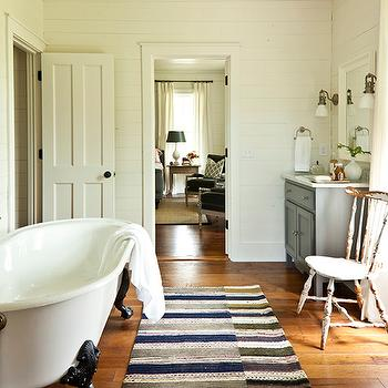 Southern Living - bathrooms - wood panels, claw foot, tub, gray, single bathroom vanity, marble, top, wood floors, claw foo tub,  Cottage bathroom