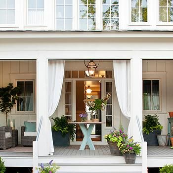 Southern Living - porches - covered porch, wraparound porch,  Wraparound covered porch with outdoor furniture.