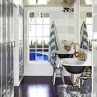House Beautiful - bathrooms - Benjamin Moore - Snow on the Mountain - glossy, white, wood paneled, ceiling, stainless steel, built-in, lockers, brockway sink,