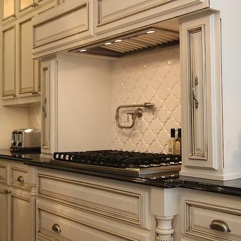 M. E. Beck Design - kitchens - antique, ivory, kitchen cabinets, polished, black, granite, countertops, pot filler, arabesque tiles, arabesque tile backsplash, arabesque tile, arabesque tile kitchen, arabesque backsplash tiles, Mission Stone & Tile Beveled Arabesque Tiles,