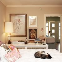 Apartment Therapy - bedrooms - tan, walls, pink, pillows, white, metal, bed, white, mirrored, dresser,  Ethereal bedroom with soft tan walls