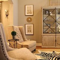 M. E. Beck Design - living rooms: gray, walls, tufted, wingback, chairs, directoire, table, zebra, cowhide, rug, layered, jute, rug, gray washed, cabinet, gray cabinet, glass front cabinet, gray glass front cabinet,