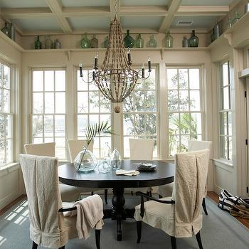 Tammy Connor Interior Design - dining rooms - tan, walls, blue, ceiling, coffered ceiling, recycled glass, vases, black, pedestal, table, linen, slipcover, dining chairs, sunroom design, sunroom dining room, dining room sunroom, Arteriors Louis Iron and Wood Chandelier,