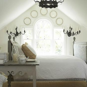 Jackie Lanham - bedrooms: attic, gray, damask, bed, headboard, footboard, gray, table, decorative, plates, iron, sconces, iron, chandelier, decorative plates, wall decorative plates, decorative plates for wall, decorative plates for bedroom wall, decorative wall plates,