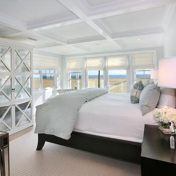 Natalie Umbert - bedrooms: glossy, white, coffered ceiling, white, antique, mirrored, cabinet, armoire, mirrored, desk, ebony, wood, bed, blue, duvet, shams, ebony, nightstand, mercury glass, lamp, mirrored armoire, white mirrored armoire,