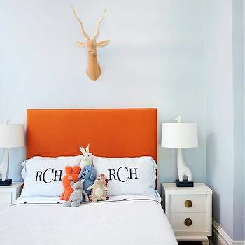 Amie Corley Interiors - boy's rooms - blue, walls, orange, headboard, white, nightstands, monogrammed, duvet, shams, orange and blue boys room, orange and blue boys bedroom, Jonathan Adler Giraffe Lamp,