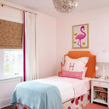 Amie Corley Interiors - girl's rooms - pale, pink, walls, white, drapes, fuchsia, ribbon, trim, layered, bamboo, roman shade, orange, clipped corners, headboard, pink, lumbar, pillow, blue, throw, pink, orange, rug, pink, flamingo, art, print, orange headboard, twin headboard, twin orange headboard, orange twin headboard, Viva Terra Lotus Flower Chandelier, Turquoise Moroccan Leather Pouf, Stray Dog Designs Jarmin Lamp in White,